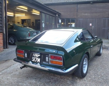Datsun 260z leaving the workshop after damage repairs